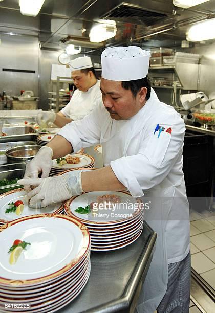 Filippino cook preparing entree
