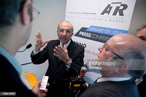 Filippo Bagnato, chief executive officer of Avions de Transport Regional , center, gestures as he speak with journalists following a news conference...