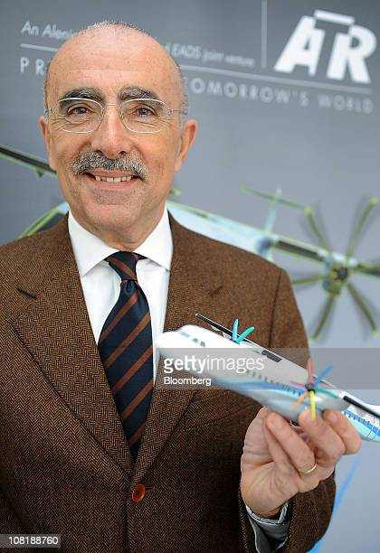 Filippo Bagnato, chief executive officer of Avions de Transport Regional , poses for a photograph with an ATR 72-600 model aircraft prior to a news...