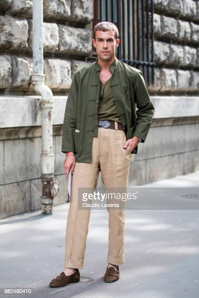 Filippo Cirulli wearing a beige pants green jacket and t shirt is seen in the streets of Paris before the Dior Homme show during Paris Men's Fashion...