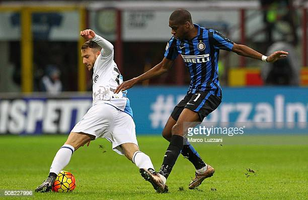 Filippo Costa of AC Chievo Verona is challenged by Geoffrey Kondogbia of FC Internazionale Milano during the Serie A match between FC Internazionale...
