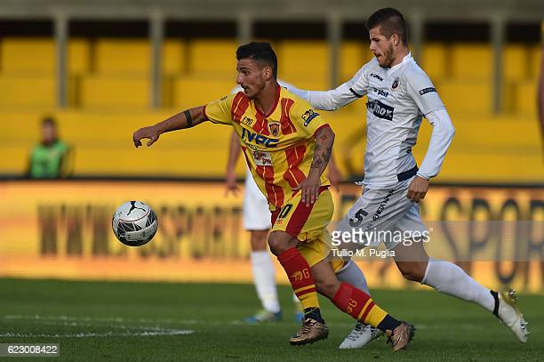 Filippo Falco of Benevento and Luca Valzania of of Cittadella compete for the ball during the Serie B match between Benevento Calcio and AS...