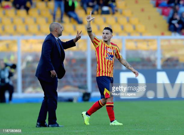 Filippo Falco of Lecce celebrates after scoring his team's first goal during the Serie A match between US Lecce and Genoa CFC at Stadio Via del Mare...