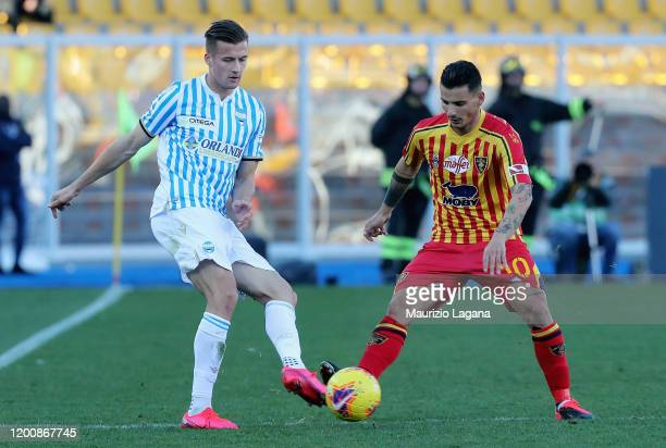 Filippo Falco of Lecce competes for the ball with Arkadiusz Reca of Spal during the Serie A match between US Lecce and SPAL at Stadio Via del Mare on...