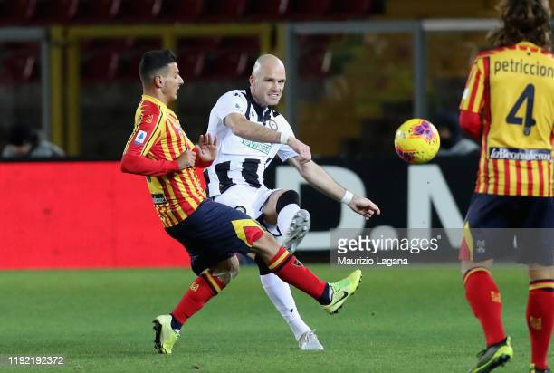 Filippo Falco of Lecce competes for the ball with Brum Nuytinkc of Udinese during the Serie A match between US Lecce and Udinese Calcio at Stadio Via...