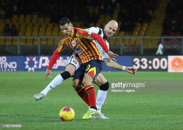 Filippo Falco of Lecce competes for the ball withBram Nuytinkc of Udinese during the Serie A match between US Lecce and Udinese Calcio at Stadio Via...