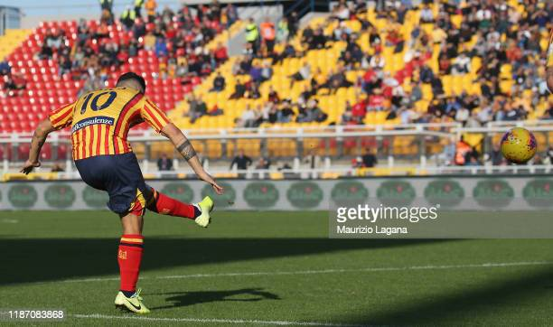 Filippo Falco of Lecce scores his team's first goal during the Serie A match between US Lecce and Genoa CFC at Stadio Via del Mare on December 8,...