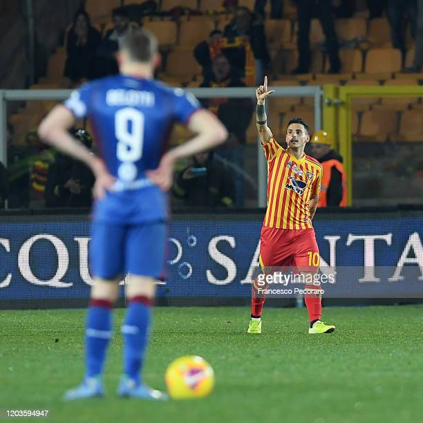 Filippo Falco of US Lecce celebrates after scoring the 30 goal beside the disappointment of Andrea Belotti of Torino FC during the Serie A match...