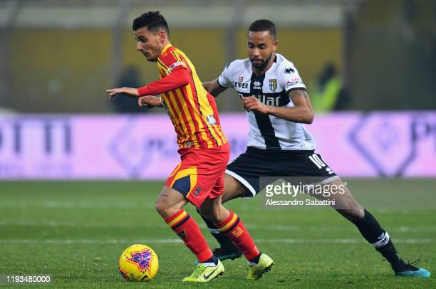 Filippo Falco of US Lecce competes for the ball with Hernani of Parma Calcio during the Serie A match between Parma Calcio and US Lecce at Stadio...