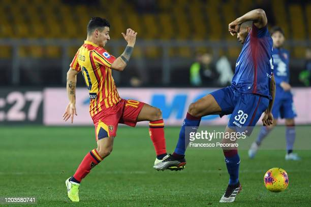 Filippo Falco of US Lecce vies with Bremer of Torino FC during the Serie A match between US Lecce and Torino FC at Stadio Via del Mare on February 02...