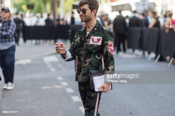 Filippo Fiora wearing miliary jacket and pants outside Valentino during Paris Fashion Week Menswear Spring/Summer 2018 on June 21 2017 in Paris France