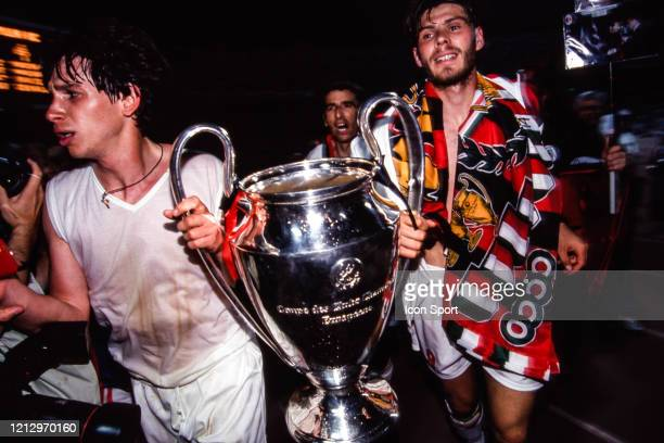 Filippo GALLI and Zvonimir BOBAN of Milan AC celebrates the victory with the trophy during the Champions League Final match between Milan AC and...