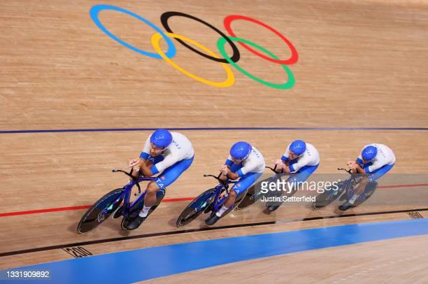 Filippo Ganna, Francesco Lamon, Simone Consonni and Jonathan Milan of Team Italy sprint to set a new Olympic record during the Men´s team pursuit...