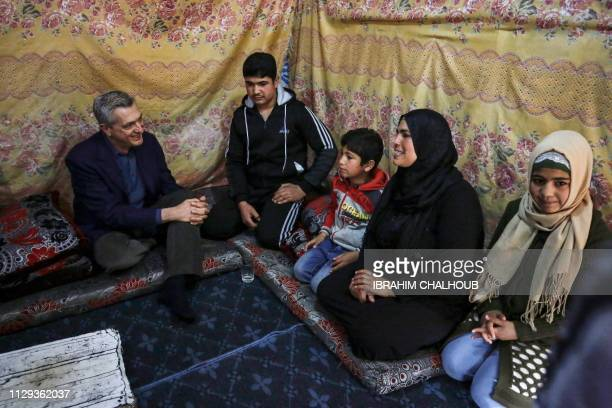 Filippo Grandi the United Nations High Commissioner for Refugees meets with a Syrian family in a tent at a refugee camp in the village of Mhammara in...