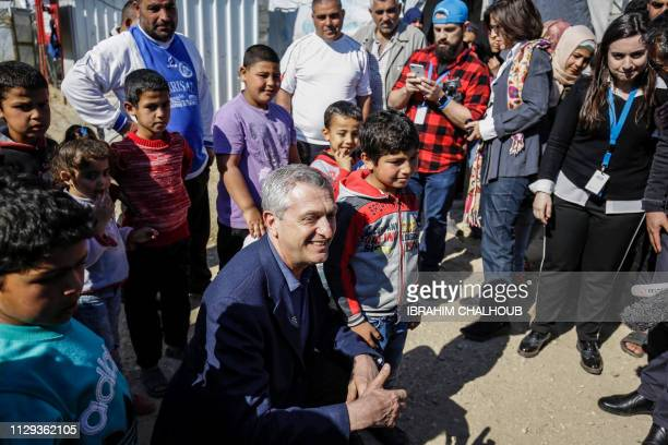 Filippo Grandi the United Nations High Commissioner for Refugees poses for a picture with Syrian refugee children at a camp in the village of...