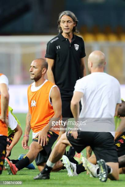 Filippo Inzaghi Benevento Calcio coach takes his players through warm-up before the serie B match between Benevento Calcio and AS Livorno at Stadio...