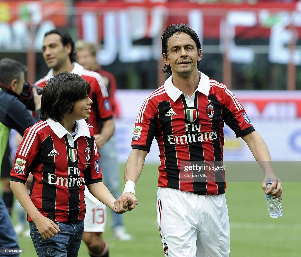 Filippo Inzaghi of AC Milan and his nephew Tommaso Inzaghi salute the audience after his last game for AC Milan during the Serie A match between AC Milan and Novara Calcio at Stadio Giuseppe Meazza on May 13, 2012 in Milan, Italy.