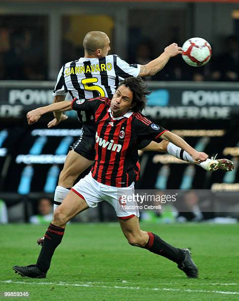 Filippo Inzaghi of AC Milan battles for the ball against Fabio Cannavaro of Juventus FC during the Serie A match between AC Milan and Juventus FC at...