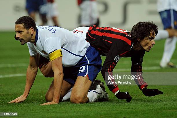 Filippo Inzaghi of AC Milan clashes with Rio Ferdinand of Manchester United during the UEFA Champions League round of 16 first leg match between AC...