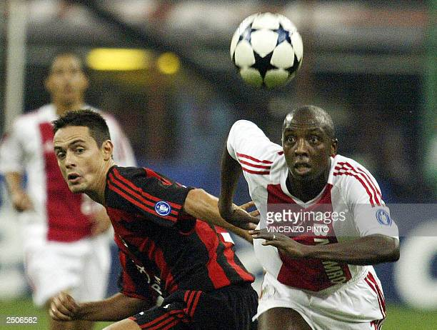 Filippo Inzaghi of AC Milan figths for the ball with AFC Ajax's Abubakari Yabuku during their Champions League Group H match at Meazza stadium in...