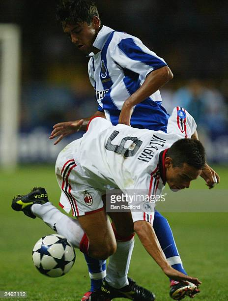 Filippo Inzaghi of AC Milan is brought down by Ricardo Costa of FC Porto during the UEFA Super Cup Final match held on August 29 2003 at the Stade...