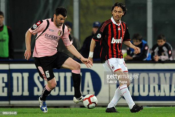 Filippo Inzaghi of Milan and Cesare Bovo of Palermo compete for the ball during the Serie A match between US Citta di Palermo and AC Milan at Stadio...
