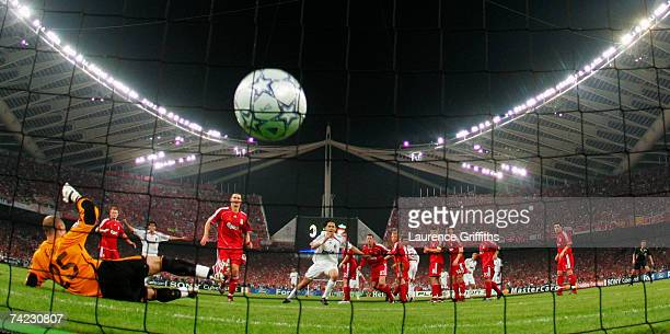 Filippo Inzaghi of Milan turns away to celebrate after scoring the opening goal past the diving Pepe Reina of Liverpool during the UEFA Champions...