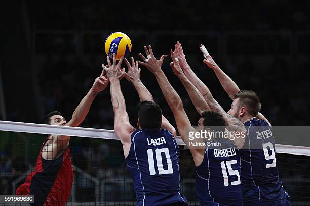 Filippo Lanza Emanuele Birarelli and Ivan Zaytsev of Italy in defence against the united States during the Men's Volleyball Semifinal match on Day 14...