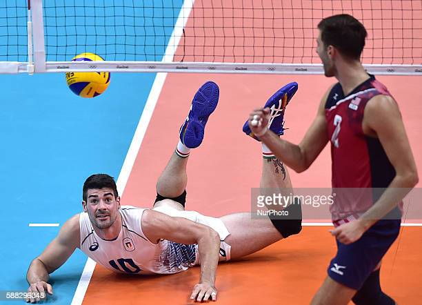 Filippo Lanza of Italy reacts against Aaron Russell from the United States of America during the men's volleyball preliminary match at the 2016 Rio...