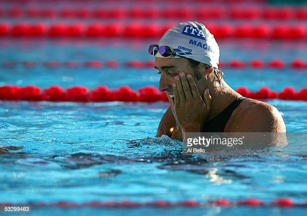 Filippo Magnini of Italy celebrates after winning the gold medal in the 100 meter Freestyle final during the XI FINA World Championships at the Parc...