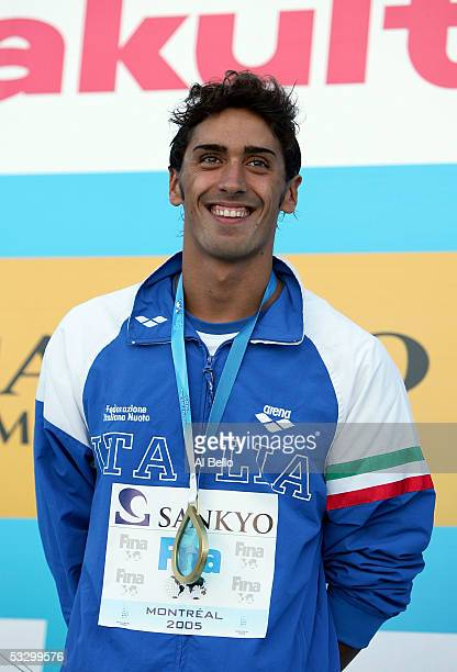 Filippo Magnini of Italy smiles on the podium after receiving the gold medal for the 100 meter Freestyle final during the XI FINA World Championships...
