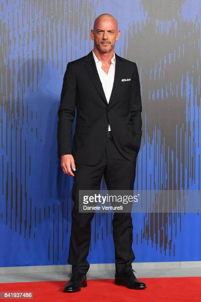 Filippo Nigro walks the red carpet ahead of the 'Suburra La Serie' screening during the 74th Venice Film Festival at Sala Giardino on September 2...