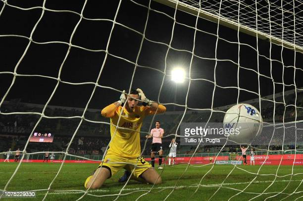 Filippo Perucchini, goalkeeper of Ascoli, shows his dejection after scoring an own goal during the Serie B match between US Citta di Palermo and...