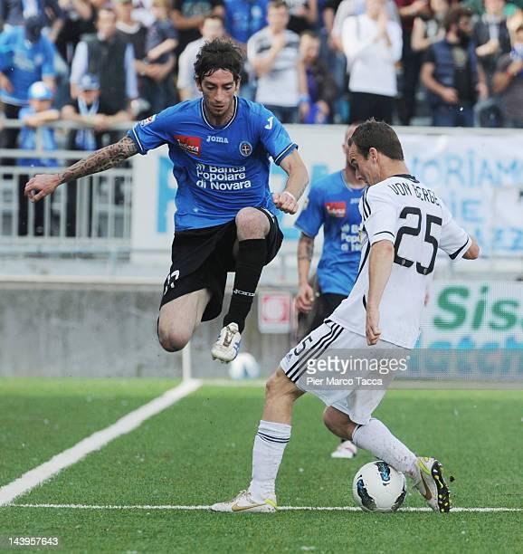 Filippo Porcari of Novara calcio fights for the ball with Steve Von Bergen of AC Cesena during the Serie A match between Novara Calcio and AC Cesena...