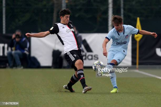Filippo Ranocchia of Juventus Turin U19 and Fernando Medrano of Atletico Madrid U19 battle for the ball during the UEFA Youth League match between...