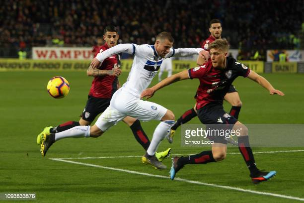 Filippo Romagna of Cagliari and Hans Hateboer of Atalanta compete for the ball during the Serie A match between Cagliari and Atalanta BC at Sardegna...