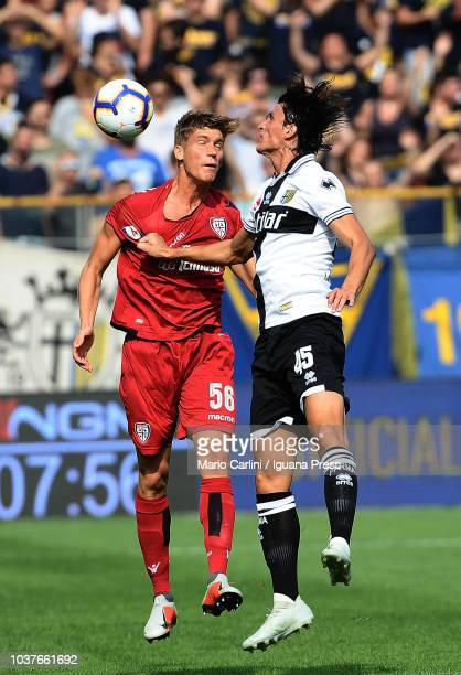 Filippo Romagna of Cagliari heads the ball during the serie A match between Parma Calcio and Cagliari at Stadio Ennio Tardini on September 22 2018 in...