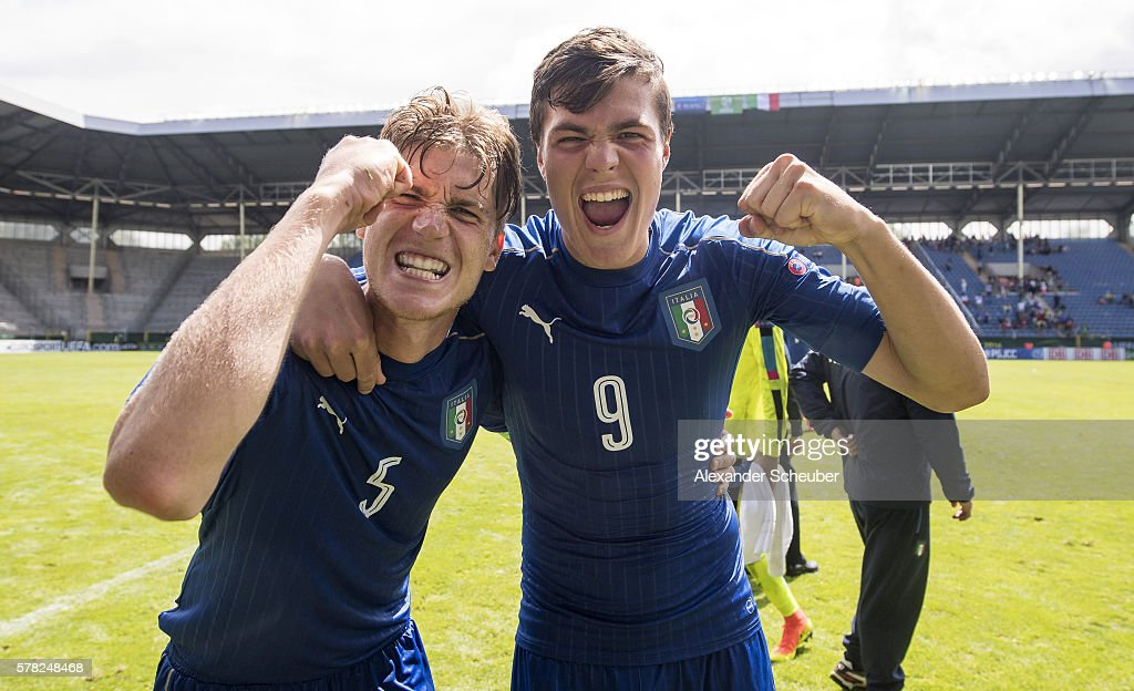 Filippo Romagna of Italy and Andrea Favilli of Italy celebrate winning the semi final during the U19 Match between England and Italy at Carl-Benz-Stadium on July 21, 2016 in Mannheim, Germany.