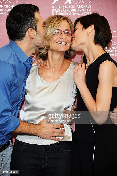 Filippo Timi and Claudia Pandolfi kiss director Cristina Comencini at the Quando la notte Photocall during the 68th Venice International Film...