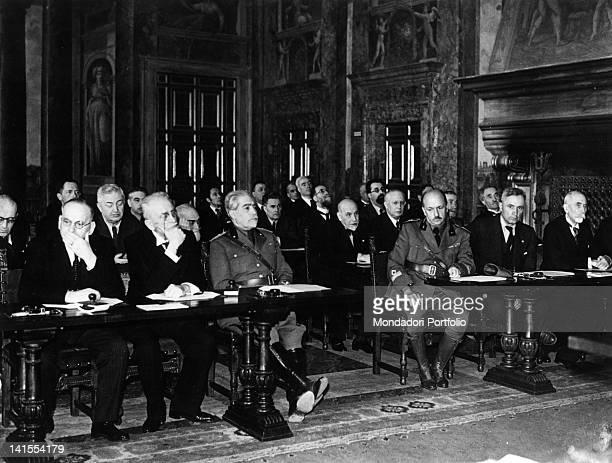Filippo Tommaso Marinetti Massimo Bontempelli and Luigi Pirandello participating in the session for the proclamation of the colonial Fascist Empire...