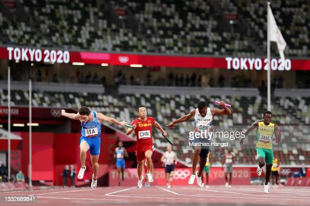 Filippo Tortu of Team Italy beats Nethaneel Mitchell-Blake of Team Great Britain across the finish line to win the gold medal in the Men's 4 x 100m...