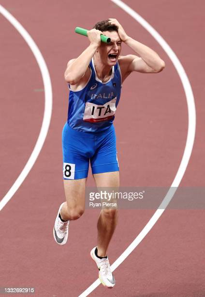Filippo Tortu of Team Italy celebrates after winning the gold medal in the Men's 4 x 100m Relay Final on day fourteen of the Tokyo 2020 Olympic Games...
