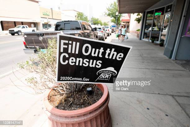 Fill Out the Census sign stands in a planter on Main Street in Roswell, N.M. On Friday, Aug. 21, 2020.
