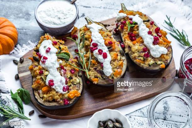 Filled aubergine, bulgur, pumpkin, pomegranate, zucchini, rosmary, tzaziki, mint, vegetables