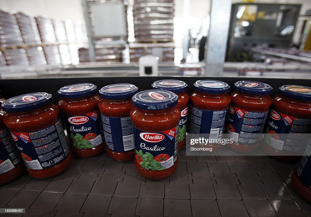 inside barilla spa s new plant for italian pasta manufacturing  filled jars of pasta sauce travel along a conveyor belt ahead of packaging at barilla holding
