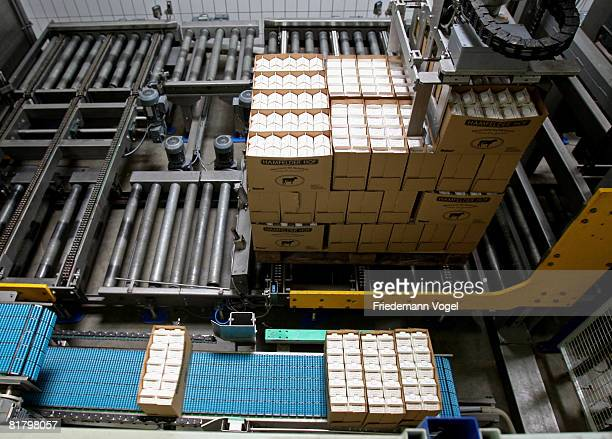 Filled milk cartons in the storage of the MeyereiTrittau dairy plant on July 2 2008 in Trittau Germany German dairy farmers recently struck with milk...