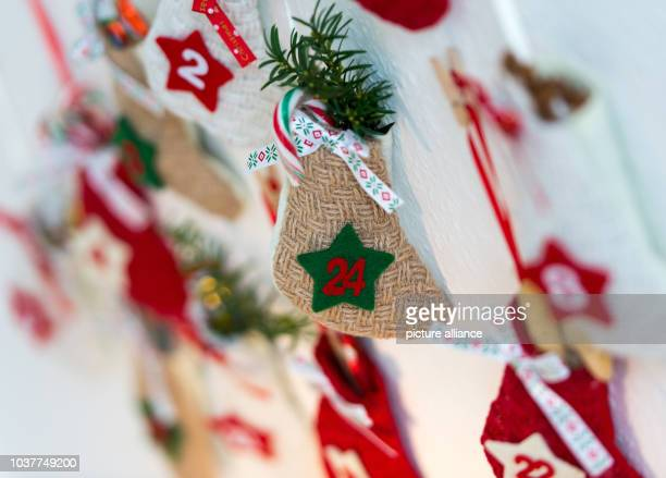 A filled pouch that reads '24' representing Christmas eve pictured on a selfmade Advent calendar on a wall in Juelich Germany 29 November 2015 Photo...