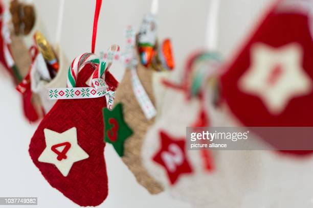 A filled pouch that reads '4' pictured on a selfmade Advent calendar on a wall in JuelichGermany 29 November 2015 Photo Monika Skolimowska/dpa |...