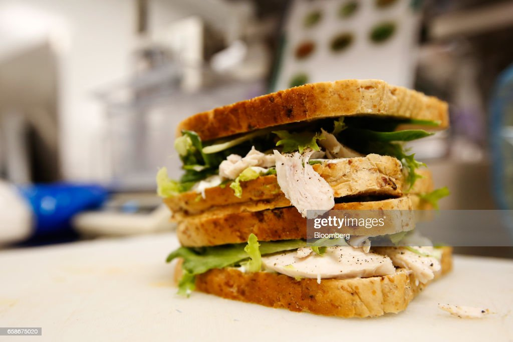 A filled sandwich sits on chopping board waiting to be sliced in the kitchen of a branch of food retailer Pret a Manger Ltd. in London, U.K., on Monday, March 27, 2017. Food chain Pret a Manger said it's concerned about Brexit because just one in 50 applicants seeking jobs is British. Photographer: Luke MacGregor/Bloomberg via Getty Images
