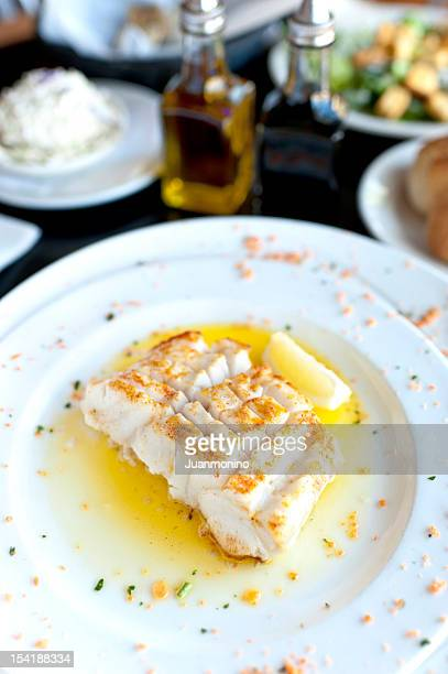 fillet of fish in butter lemon sauce - bechamel sauce stock photos and pictures